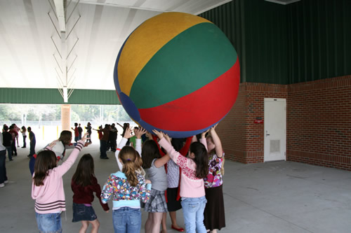 Students playing with a huge ball