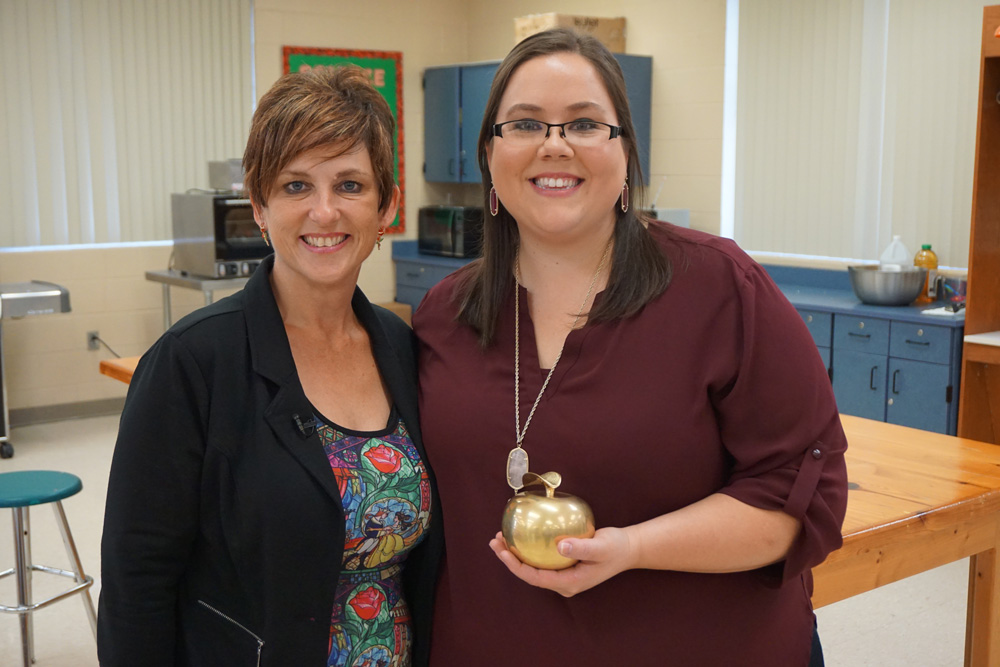 Supt. Dr. Heidi Maier congratulates West Port High's Cacee Ford, 2017 Golden Apple Teacher